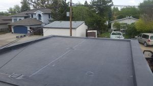 Flat Roof Replacement Calgary. EPDM. Stock image of EPDM installation.