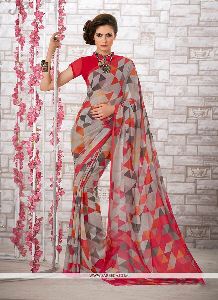 Genuine elegance comes out of your dressing style with this multi colour georgette printed saree. Beautified with print work all synchronized very well with the trend and design of the attire. Comes w...