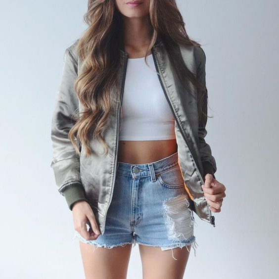 A nicely put together combination of a grey bomber jacket and light blue ripped denim shorts will set you apart effortlessly.   Shop this look on Lookastic: https://lookastic.com/women/looks/grey-bomber-jacket-white-cropped-top-light-blue-denim-shorts/18804   — Grey Bomber Jacket  — White Cropped Top  — Light Blue Ripped Denim Shorts