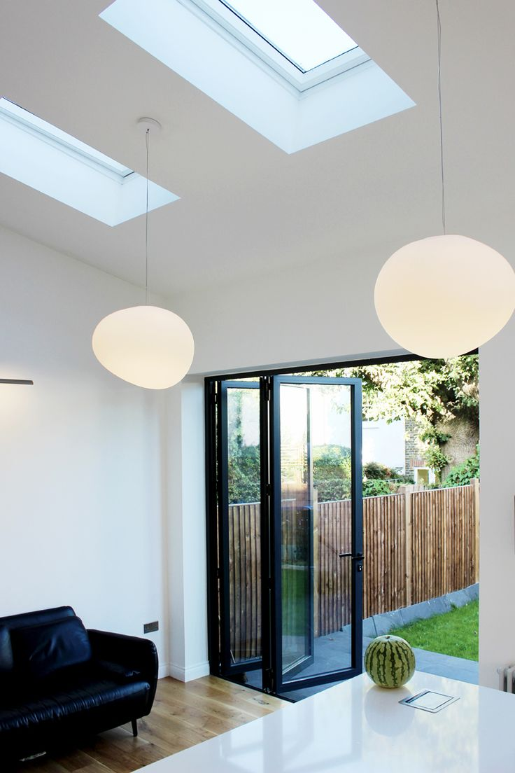 Adding VELUX roof windows in this single storey extension has created a bright space for family and friends to enjoy.  Image supplied by 11.04/Creative Intelligent Design Ltd, London.