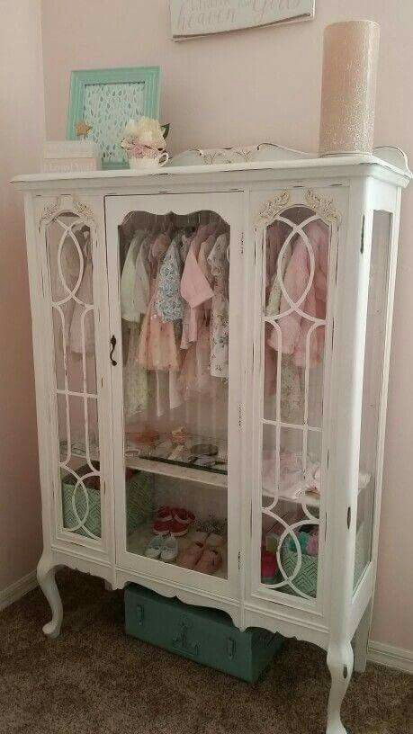 A vintage china hutch is turned into a delightful child's clothing storage display! Shared via FB re-scape.com