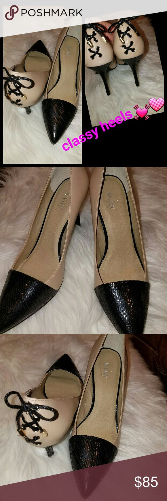Classy Heels ! Brand new! Two-toned! Brand: Levity. Two- toned heel with details! Black and cream! Goes with anything!! Tie up back. Size 8.5 Happy Poshing!!! Shoes Heels