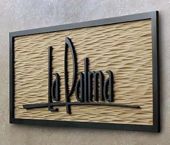 V carved sign. Like the background.