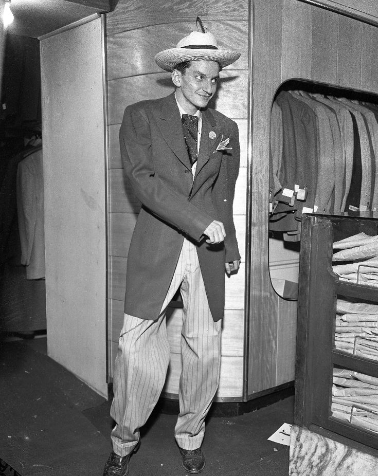 Zoot Suit: an extreme form of the sack suit with a long jacket, excessively wide shoulders, wide lapels and markedly pegged trousers. It originated in the 1940s...