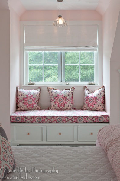 I've always wanted a window seat in my bedroom! The pink pattern is perfect for this little girl's room, and the drawers beneath the bench are so clever for storage!