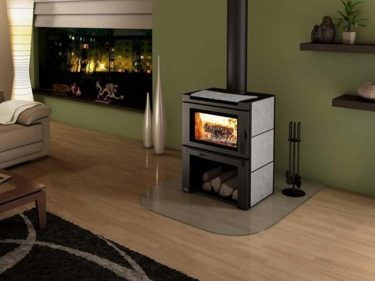 http://www.drissimm.com/wp-content/uploads/2014/10/modern-wood-burning-stoves-with-wooden-floor-living-room-and-green-painting-wall.jpg