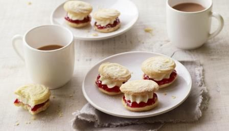 Push the boat out with these melt-in-the-mouth biscuits filled with homemade jam and vanilla buttercream.  For this recipe you will need a piping bag, a medium star nozzle, a large star nozzle, 3 baking sheets
