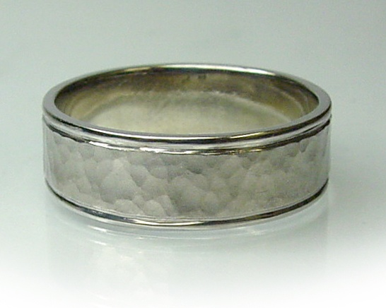 Chibnalls custom made Gents wedding ring made in 18ct white gold hammer finished by hand.