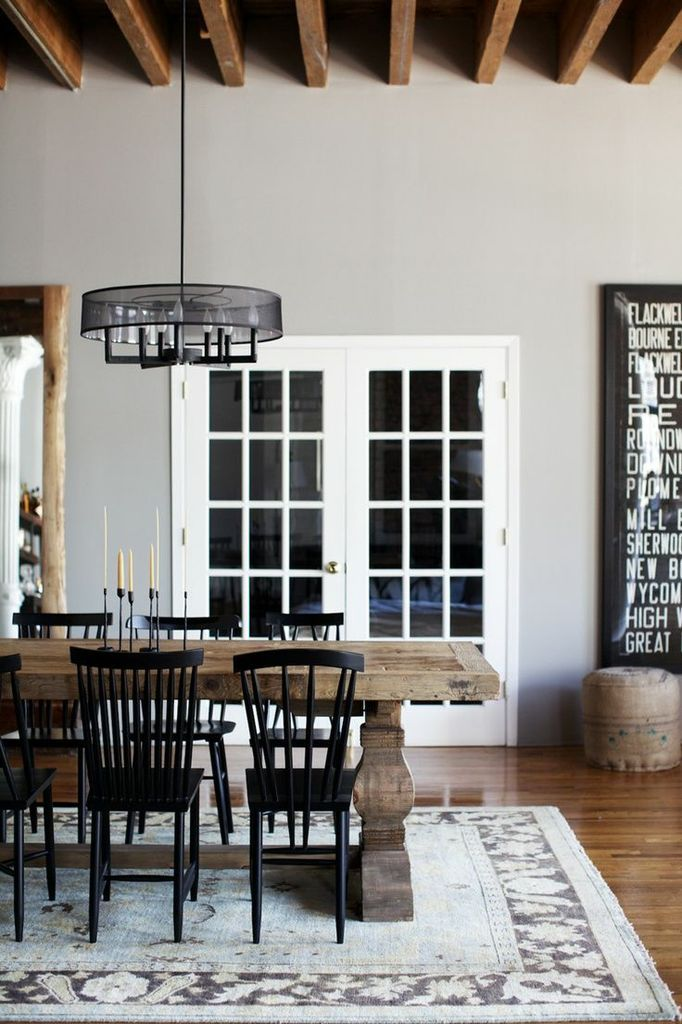 Wood Table And Black Mismatched Chairs