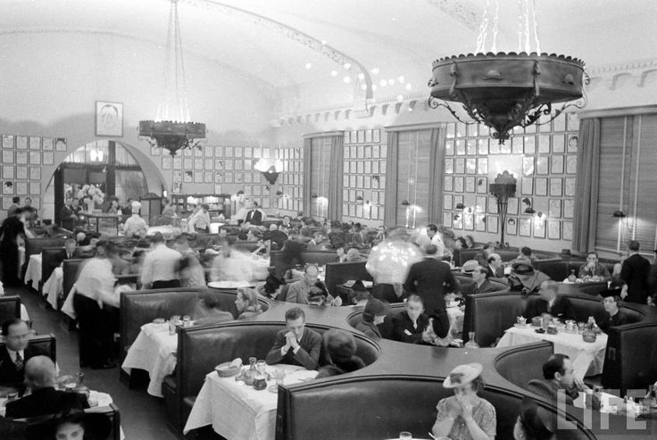What I love about this shot of the interior of the Vine Street Brown Derby from Life magazine is that it's completely unstaged. It shows the hubbub of waiters bustling around the restaurant, tending to well-dressed patrons huddled in booth, while Eddie Vitch's caricatures fill every square inch of the walls. I don't think I'd ever noticed those chandeliers before. They're really quite something, aren't they?