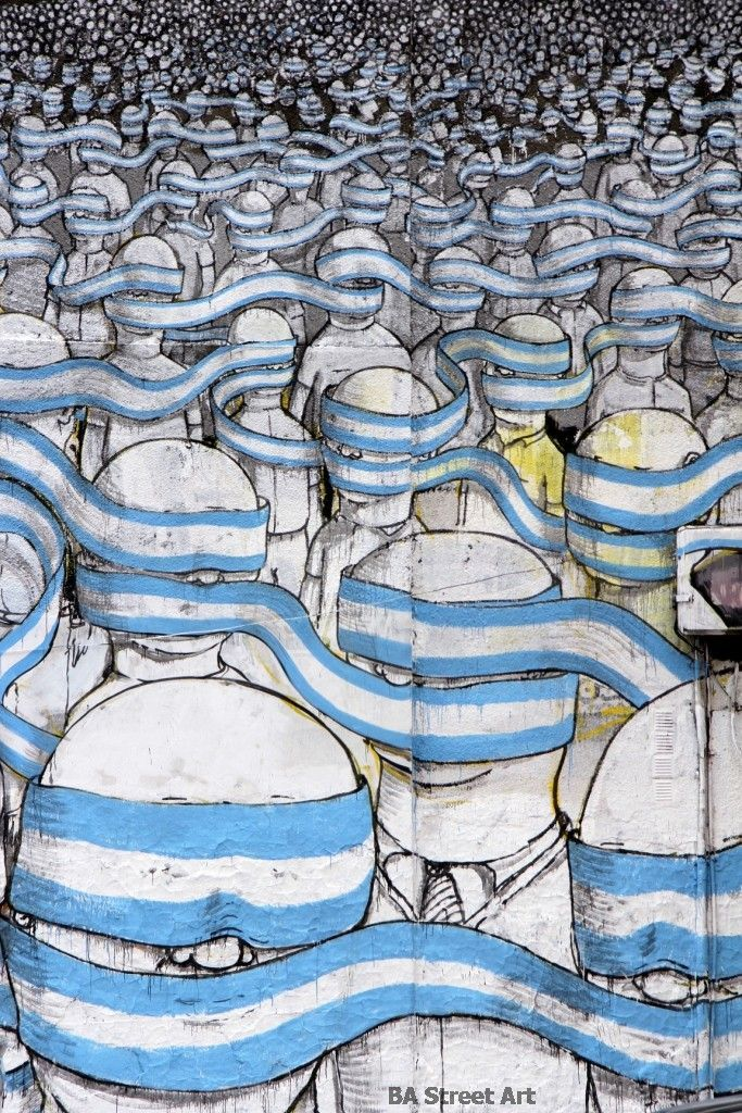 New mural by Blu in Buenos Aires. It features hundreds of figures with their eyes covered by one endless blindfold in the colours of the Argentine national flag