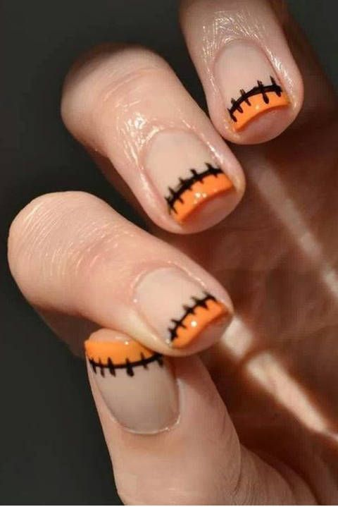 HALLOWEEN FRENCH MANI: Add some ~SpOoKy~ touches to your typical french mani with festive orange and black polish and stitching details. Find the full instructions and mani hacks here!