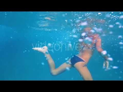 Girl Underwater in Swimming Pool (Stock Footage)