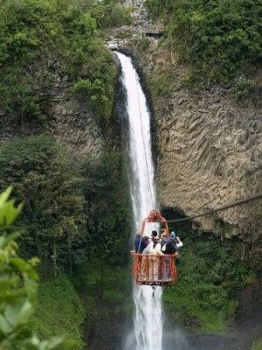 Banos, Ecuador  Can't believe it, but I did this! That basket is incredibly high off the valley floor!