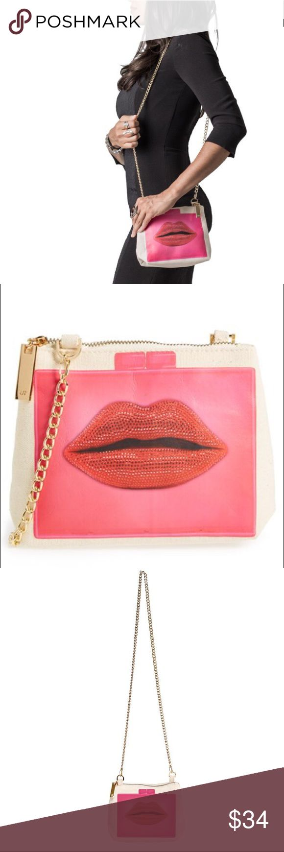 Thursday Friday Away Mini Clutch, Lips in Pink This new sold out carry-everywhere travel clutch will help you simplify any day on the go. Its removable chain strap and roomy interior makes it suitable for a chic cosmetic case or to carry all the necessities for a night out. It's ideal for keeping small valuables organized for a weekend away or everyday when slipped into an Everyday Tote.  Bundle deals 3 items and get an additional 15% off, great deal! Thursday Friday Bags Mini Bags