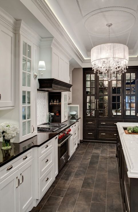 I like the blend of the white cabinets and the dark wood glass front cabinets!