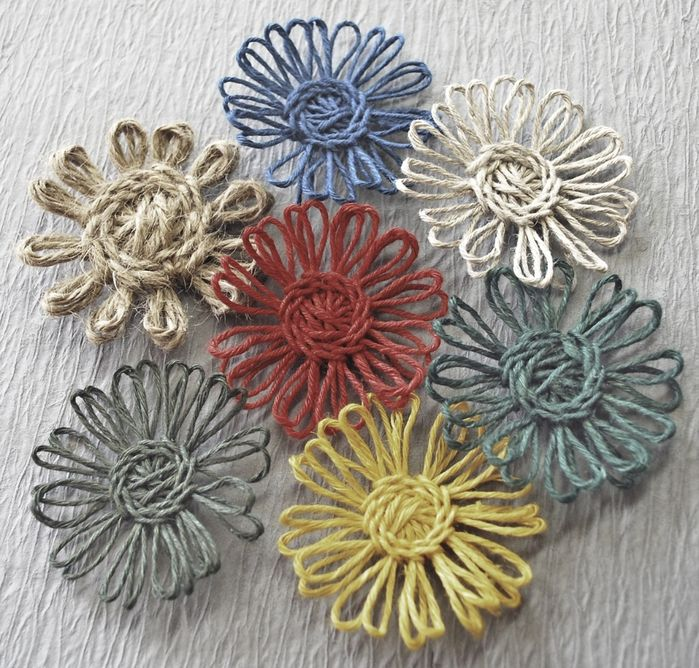 Not crochet. Twine Tutorial finished flowers. These are so beautiful! I want to make hundreds of them since I saw this. Simple, quick and easy! Imagine the possibilities see......napkin rings, brooch, hairpin,