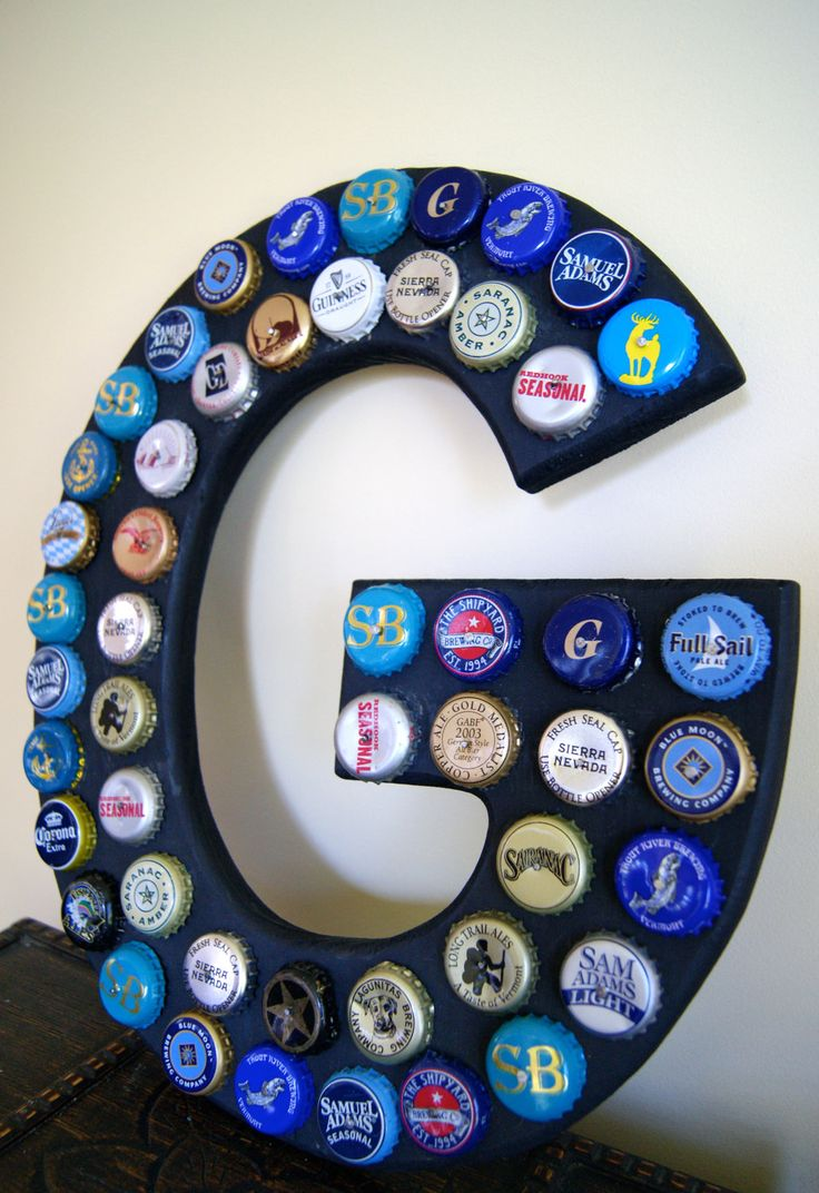 Beer Bottle Cap Sign. Might have to do this with the beer bottle caps from my Dads beer of the month beer.