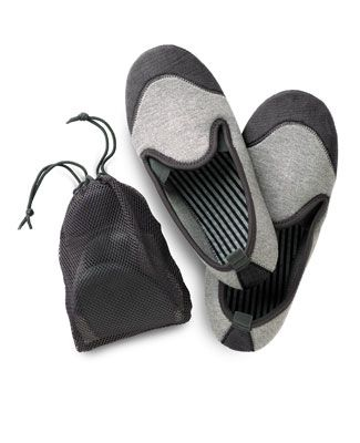 Magellan's Travel Slippers - Size L/XL, Color- Black (the dark grey looking color), made out of neoprene, perfect for flying/airtravel, and they have a small mesh bag for storage.