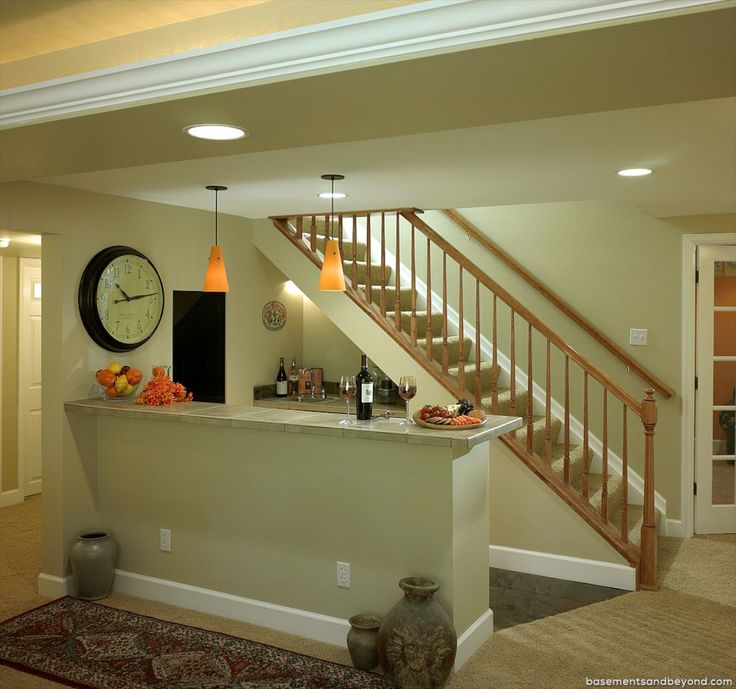 wet bar under stairs | Wet Bar includes cabinetry tucked under stairs along with a peninsula ...