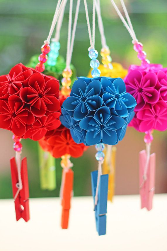 Handmade colorful origami kusudama flower ball with natural wooden clip. This is suitable for home-decor things, a gift, or souvenir in any