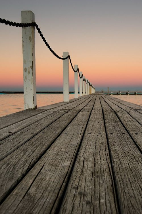 This picture is an example of leading lines because the boardwalk is leading further into the picture.