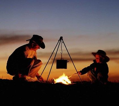 Family ties ... a camp fire in the outback.