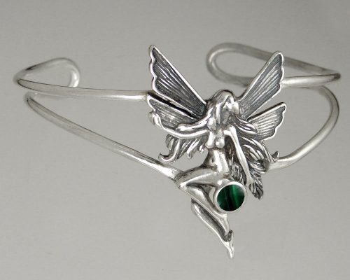 Sterling Silver Victorian Fairy Cuff Bracelet Accented with Genuine Malachite The Silver Dragon- Bracelets. $87.00. Designed And Hand- Crafted in Sterling Silver. The Silver Dragon uses Sterling Silver that has been Reclaimed... Helping Save Mother Earth's Resources.. This Unique Bracelet is Created only after Your Order Arrives. Please Allow 7-10 days for Delivery.. This Bracelet Fits a Standard Woman's Wrist. This Bracelet was Designed by The Silver Dragon, a Jewelry...