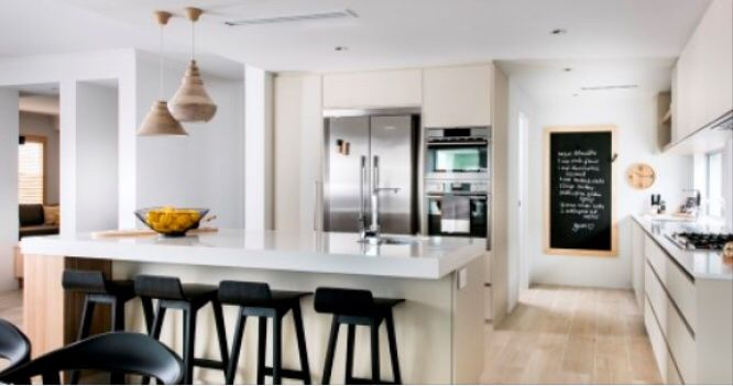 Perfect! White bench, beige cupboards and black accents. Love this kitchen.