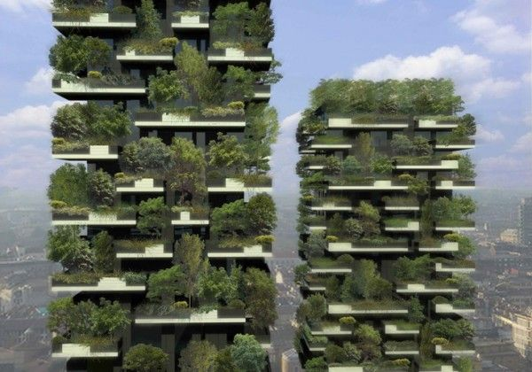 """The world's first vertical forest is rising in Milan. The Bosco Verticale, the project's official title, will be completed later this year, marking a significant step in development of green architecture. The plan consists of two apartment towers festooned with a series of concrete decks, staggered and offset from each other to give the structures their Jenga-like appearance. Once completed, nearly 2.5 acres of """"forest"""" will have been planted in these balconies.  Incredible!"""