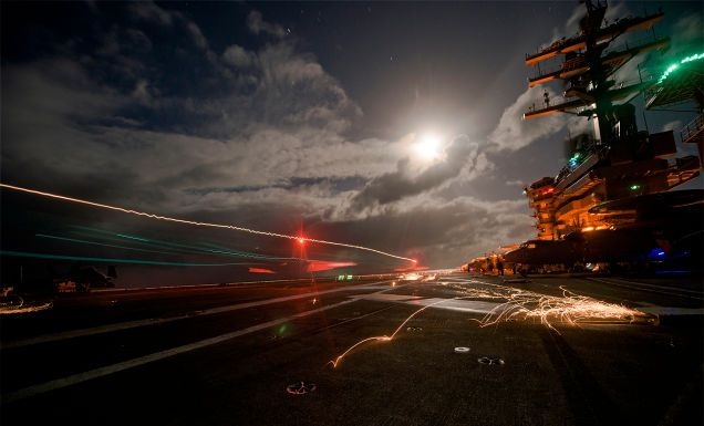 These Stunning Photos Capture Night Ops Aboard The USS Dwight D. Eisenhower