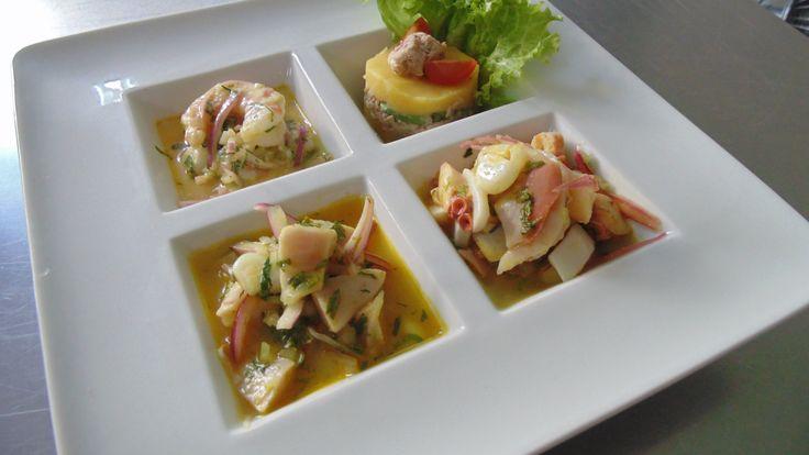 Piqueo criollo para 2-3 personas: causita limeña de atún palta, festival de mariscos, cebiches de pescado y tiradito de camarones.