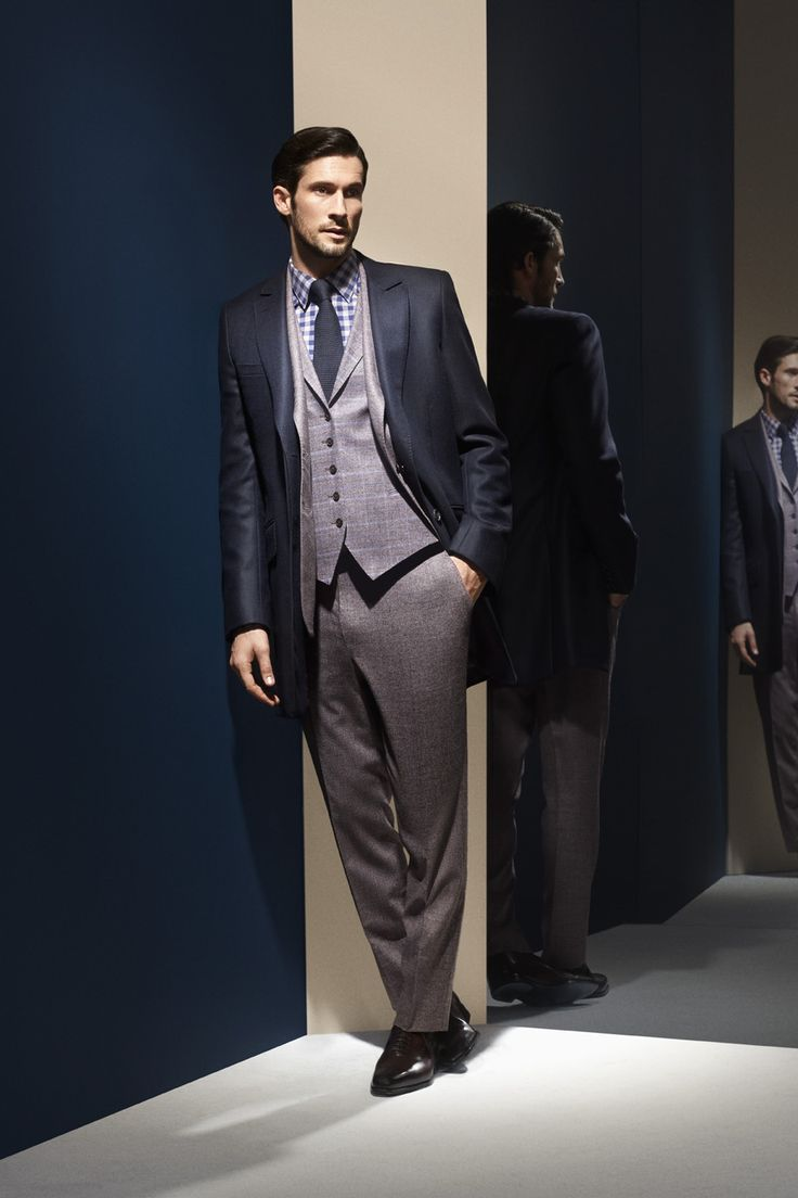 Costume trois pièces à deux boutons en laine super 150', chiné marron glacé et mauve  Photographe : Alexis Armanet Mannequin : Alban Rassier