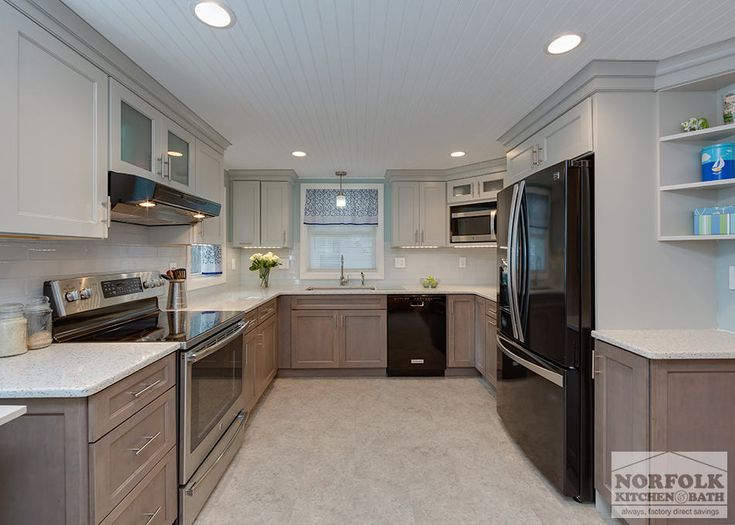 This two-tone transitional style kitchen by Showplace features a full  overlay style door and