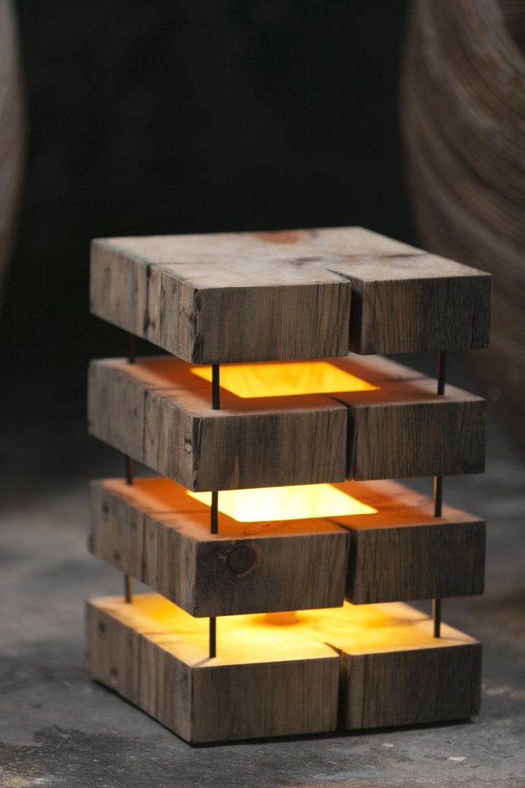 Pretty wooden lamp made with 5 slices of square wood, maintained by four metal rods.