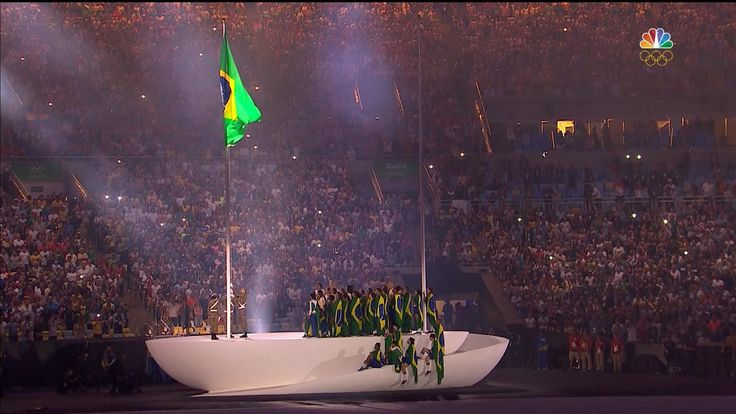 The Brazilian flag is raised during the national anthem