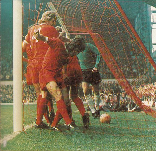 25th August 1973. Liverpool players Phil Thompson and Kevin Keegan rush to the goal to celebrate with Steve Heighway who scored the winner against Stoke City, at Anfield.