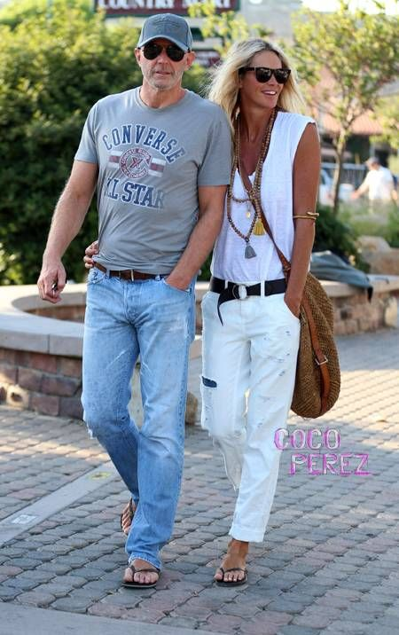Elle Macpherson wearing white in malibu with boyfriend