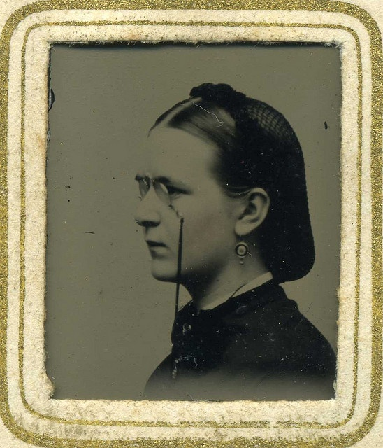 Clip nose glasses, great side view of hir net, Civil War era photo....