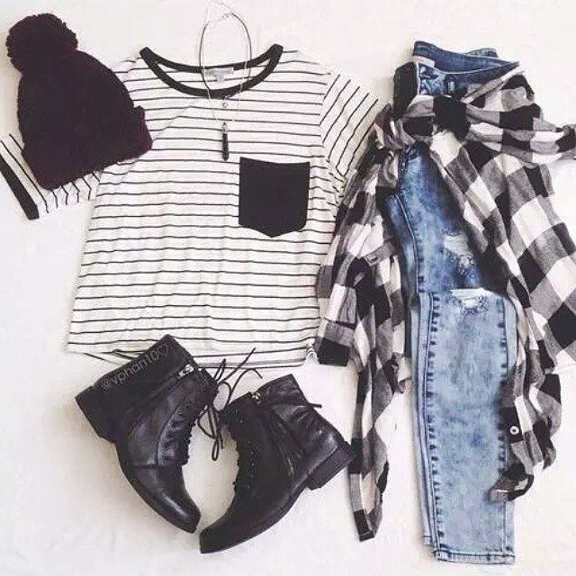 Grunge outfit idea nº5. Ripped jeans, plaid shirt, pin stripe undershirt, beanie, laced light-boots, black crystal necklace - http://ninjacosmico.com/23-awesome-grunge-outfits/