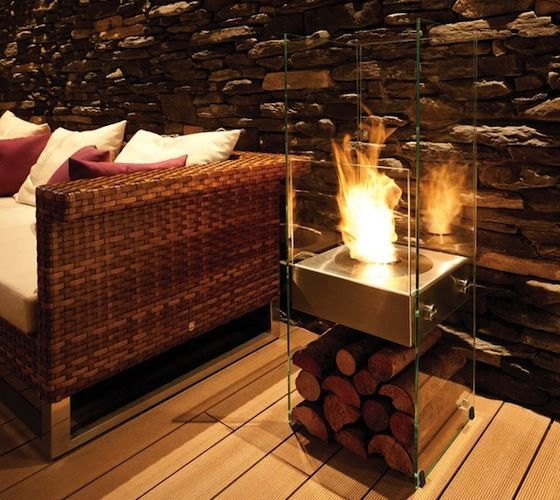 A strikingly elegant, almost invisible fireplace fashioned from toughened glass and stainless steel that lavishes design appeal on any decor.