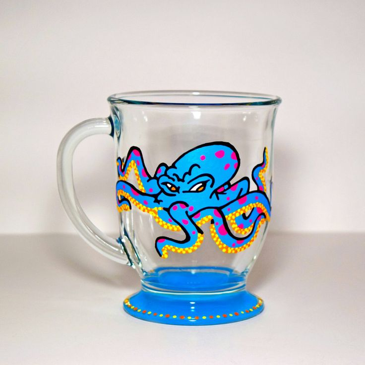 This vibrant hand painted glass mug features a graffiti style octopus. Bright colors and dotty details really make this fun character pop. These make meaningful gifts that will be cherished by the recipient.