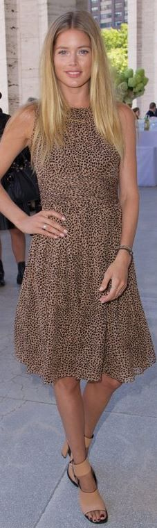 Who made Doutzen Kroes' tan shoes and brown animal print dress that she wore in New York on September 4, 2013?