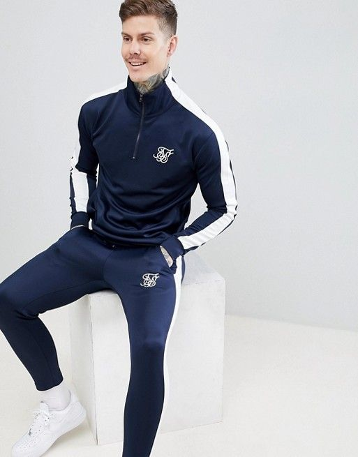 33b0699bce7f SikSilk cropped jogger in navy with white side stripe