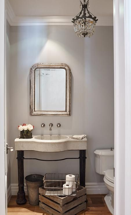 Gray French Powder Room Features Walls Painted Creamy Gray Lined With A Silver Leaf Beaded