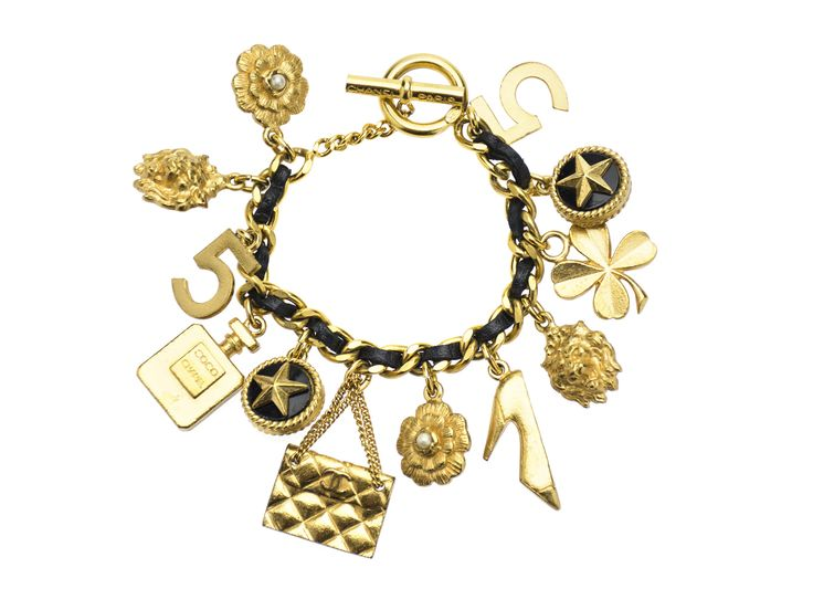 This is one of our favorite pieces from 1995 that incorporates the signature chain and leather design by Chanel. Selection of charms include camellia flower with a pearl center, leo head, perfume bott