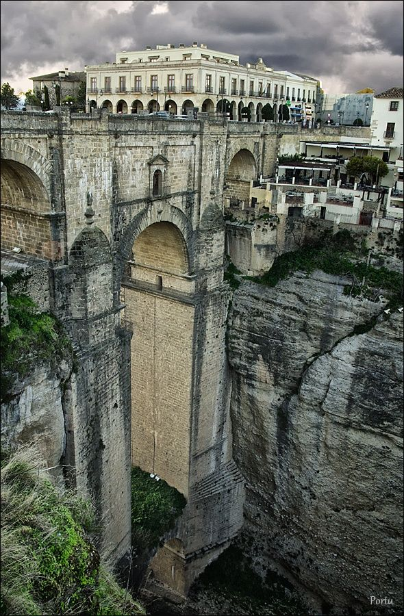 Ronda - Málaga, Spain. Puente Nuevo, one of three bridges that span the deep canyon carved by the Guadalevín River. Built in 1751-1793, it is the  tallest of the bridges, towering 120 metres (390 ft) above the canyon floor.