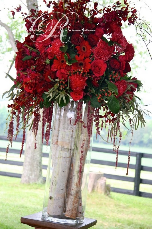 Vase filled with birch logs gives the illusion of a taller floral arrangement. Rustic & classy