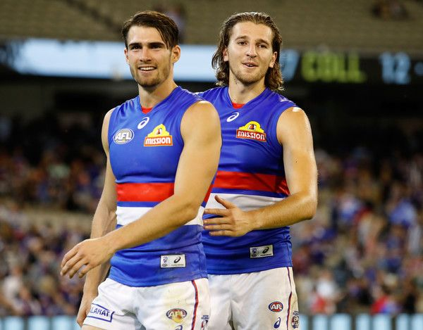 Marcus Bontempelli Photos Photos - Easton Wood (left) and Marcus Bontempelli of the Bulldogs celebrate during the 2017 AFL round 01 match between the Collingwood Magpies and the Western Bulldogs at the Melbourne Cricket Ground on March 24, 2017 in Melbourne, Australia. - AFL Rd 1 - Collingwood v Western Bulldogs