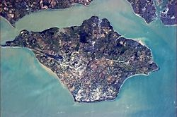 Isle of Wight-- is a county and the largest and second most populous island in England. It is located in the English Channel, about 4 mi (6 km) off the coast of Hampshire and is separated from mainland Great Britain by the Solent. The island has several resorts which have been holiday destinations since Victorian times.